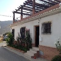 Casa adosada en esquina en el Romeral-Castell de Ferro