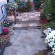 Detalle zona de jardín, entrada de calle.