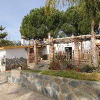 Casa de campo con parcela en venta en Coín