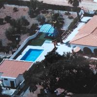 parcela con casa y piscina